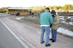 Dave Hoffman and Lynette Perry pray in front of Red Feather Lakes Elementary on Jan. 24, 2013.