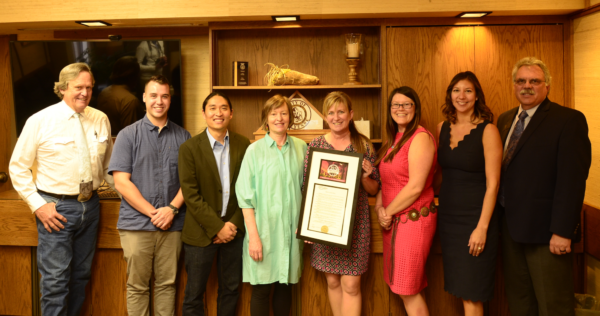 A Downtown Fort Collins Business Association delegation delivers the Wyoming Appreciation Weekend proclamation to Mayor Marian Orr at Cheyenne City Hall in October, 2018. Pictured from left to right: Pete Laybourn, Cheyenne City Council Ward I; Cameron Lalor, Downtown Business Association; James Yearling, Downtown Business Association; Susan Kirkpatrick, owner of Savory Spice Shop and former Fort Collins Mayor; Cheyenne Mayor, Marian Orr; Hannah Baltz-Smith, Downtown Business Association; Vanessa Kroeger, Downtown Business Association; Clark Harris, Laramie County Community College Vice President of Academic Affairs.